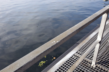 Railing by water