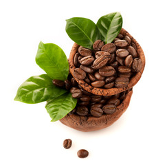 Bowl of coffee beans on a white background