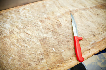 Kitchen knife on wooden cutting board in store