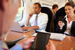 Businesspeople On Train Using Digital Devices