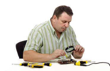 Technician looks at the video card
