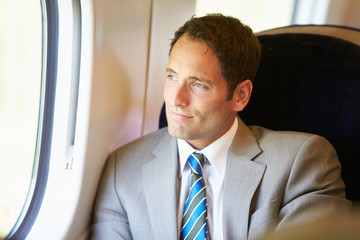 Businessman Relaxing On Train Journey