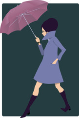 Woman with an umbrella in 1960s style clothes