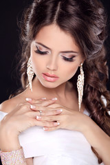 Beautiful young bride portrait in white dress. Fashion Beauty Gi
