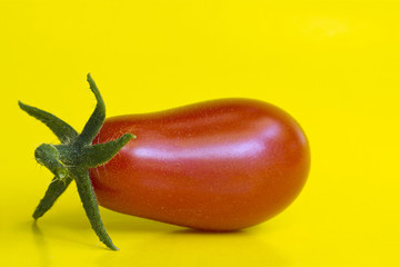 Tomatoes on a yellow background