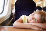 Girl Relaxing On Train Journey
