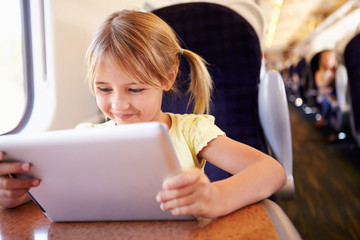 Girl Using Digital Tablet On Train