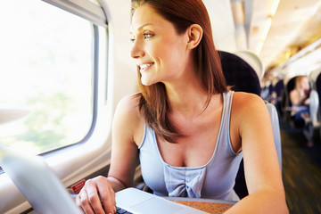 Woman Using Laptop On Train