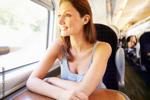 Woman Relaxing On Train Journey