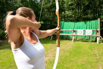 Woman target shooting