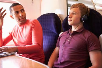 Young Man Disturbing Train Passengers With Loud Music