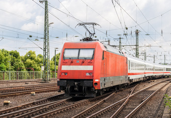 Electric locomotive with passenger train in Cologne, Germany