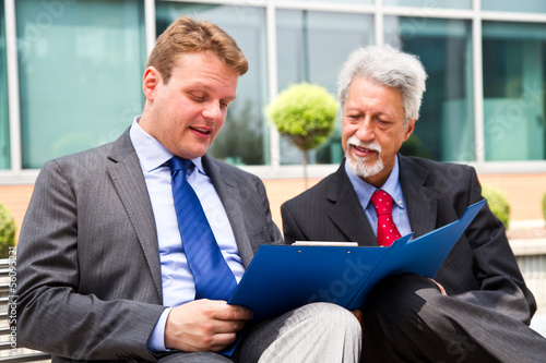Two business men partner talking about project