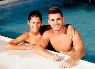 Happy couple relaxing in the pool
