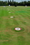 Golf driving range with yardage markers