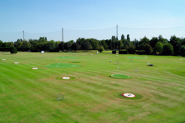 Golf driving range with distance markers
