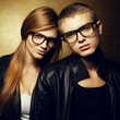 Portrait of gorgeous red-haired fashion twins in trendy glasses