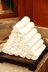white towels in bathroom shelf