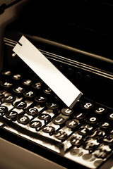 Vintage typewriter and white tag, shallow focus