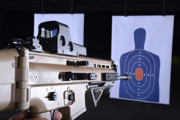 machine gun pointed at bullseye target on gun range