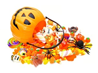 Halloween Jack o Lantern pail with spilling candy