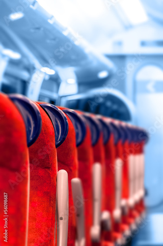 Empty Train Seats in a row - Light blue background