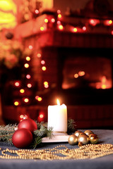 Christmas mood with baubles and candle