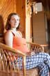 pregnant woman reading e-book