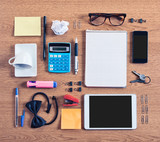 The contents of a business workspace organized and composed. poster