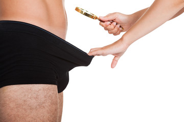 Woman looking into man's underwear