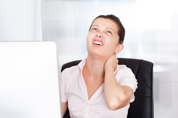 Businesswoman With Neck Pain