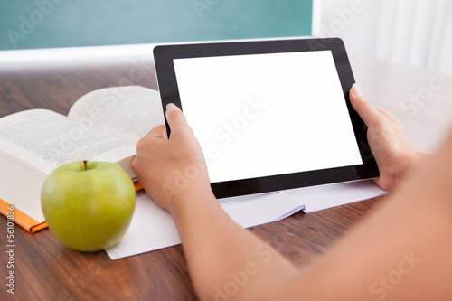 Student holding digital tablet