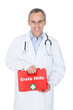 Happy male doctor carrying a portable first aid kit