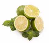 Fresh limes, mint leaves isolated on white