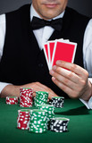 Croupier holding playing cards