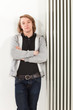 portrait of young man.leaning on the radiator