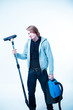 young man with a vacuum cleaner, studio portrait