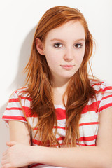 portrait of cute redheaded girl, wall background