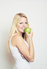 smiling beauty eating green apple