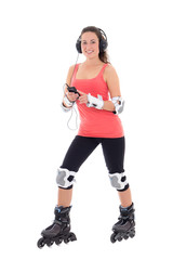 attractive woman in roller skates listening music on white backg