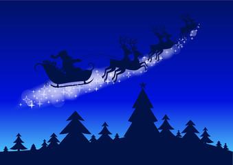 Noël - traineau au dessus de la forêt