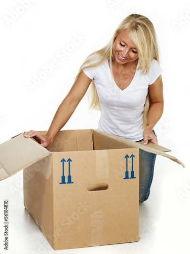 Woman clutching something in a moving box
