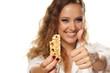 smiling beautiful girl shows muesli bar and thumbs up