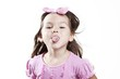 A little girl shows tongue