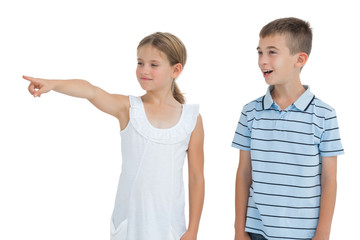 Young girl showing something to her brother