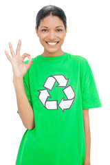 Happy model wearing recycling tshirt making okay gesture