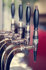 Silver and black beer taps close up