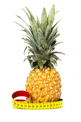 Pineapple and measuring tape isolated on white
