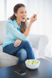 Smiling attractive woman eating healthy salad