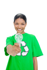 Smiling model wearing recycling tshirt holding light bulb